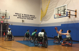Group of Boys and Girls Club playing wheelchair basketball